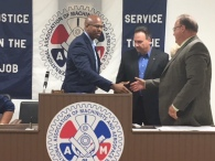 Rob Richardson, candidate for Ohio Treasurer, shakes hands with Jerry Espy, OSCM Secretary-Treasurer.